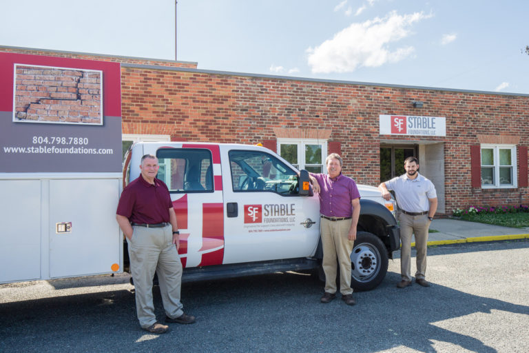 Stable Foundations foundation repair team standing next to company vehicle